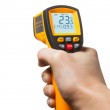 Infrared laser thermometer in hand isolated on white — Stock Photo #42582545