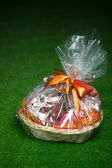 Gift basket against green lawn background — Stock Photo