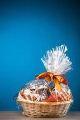 Gift basket against blue background — Stock Photo