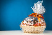 Gift basket against blue background — Stock Photo