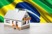 Classic house against Brazilian flag background — Stock Photo