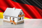Classic house against German flag background — Stock Photo