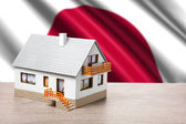 Classic house against Japanese flag background — Stock Photo