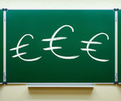 Euro signs on the blackboard — Stock Photo