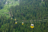 The Alps mountains cableway, forest background — Stock Photo