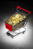 Shopping cart full of money — Stock fotografie