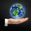 Planet Earth on a hand. Elements of this image furnished by NASA — Stock Photo