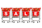 Sale concept - shopping carts with tomatoes — Stock Photo
