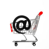Online shopping concept - shopping cart with email symbol — Stock Photo