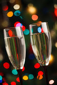 Pair of champagne glasses on the threshold of new year — Stock Photo