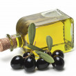 Black olives and a bottle of olive oil. — Stock Photo #11510283