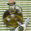 Virgin olive oil on a bamboo mat — Stock Photo