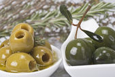 Olives and aromatic herbs — Stock Photo