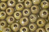 Pitted olives covered in oil — Stock Photo