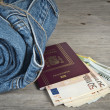 Jeans, passport and much money — Stock Photo