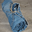 Stock Photo: Rolled jeans arranged in pyramid