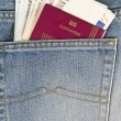Stock Photo: Passport and money in pocket