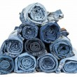 Royalty-Free Stock Photo: Rolled jeans arranged in a pyramid