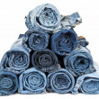 Stock Photo: Rolled jeans arranged in a pyramid