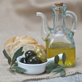 Olive oil with olives and bread — Stock Photo