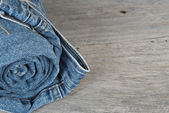 Rolled jeans arranged in a pyramid — Stock Photo