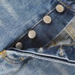 Fly of the jeans with button closure - Stock Photo
