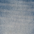 Stock Photo: Old blue jeans pattern background