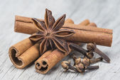 Cinnamon with anise and clove over wood — Stock Photo