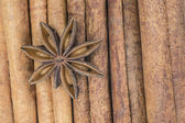 Star anise over cinnamon sticks — Stock Photo