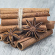 Cinnamon and star anise over wood — Stock Photo