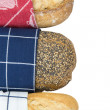 Stock Photo: Bread covered with dishcloth