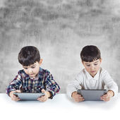 Children playing with a digital tablet — Stock Photo