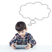 Child using a digital tablet — Stock Photo