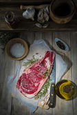 Steak on the table of the kitchen — Stock Photo