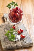 Highball cup with grape tomatoes — Stock Photo