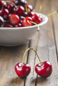 White bowl of cherries on the table — Stock Photo