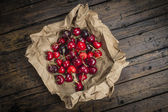 A wrapping paper with cherries on the table — Stock Photo
