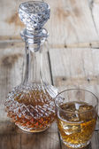 Crystal clear luxury glass bottle with liquor — Stock Photo