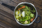 Saucepan with vegetables to cook a soup — Stock Photo