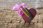 Bullet with a heart decorated like a gift — Stockfoto