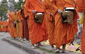 Monks walking on the street — Stock Photo