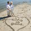 Retired Couple on Beach — Stockfoto