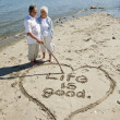 Retired Couple on Beach - Stock Photo