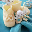 Royalty-Free Stock Photo: Blue Happy birthday cake with baby shoes