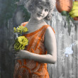 Stock Photo: Girl with flowers, Vintage Photograph from 1920era