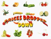 Isolated vegetables and fruit with text prices dropped down — Stock Photo