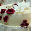 Stock Photo: Beautiful Wedding Cake with roses