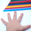 Child hand and pencils - Stock Photo