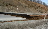 Damaged road by floods — Stock Photo