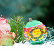Christmas ball and santa claus on pine - tree branch with snow — Stock Photo